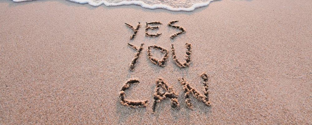 Yes You Can in het zand geschreven